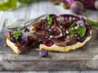 Beetroot & feta cheese tarts with tahini-dressed leaves