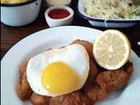 Pork schnitzel with fried duck egg